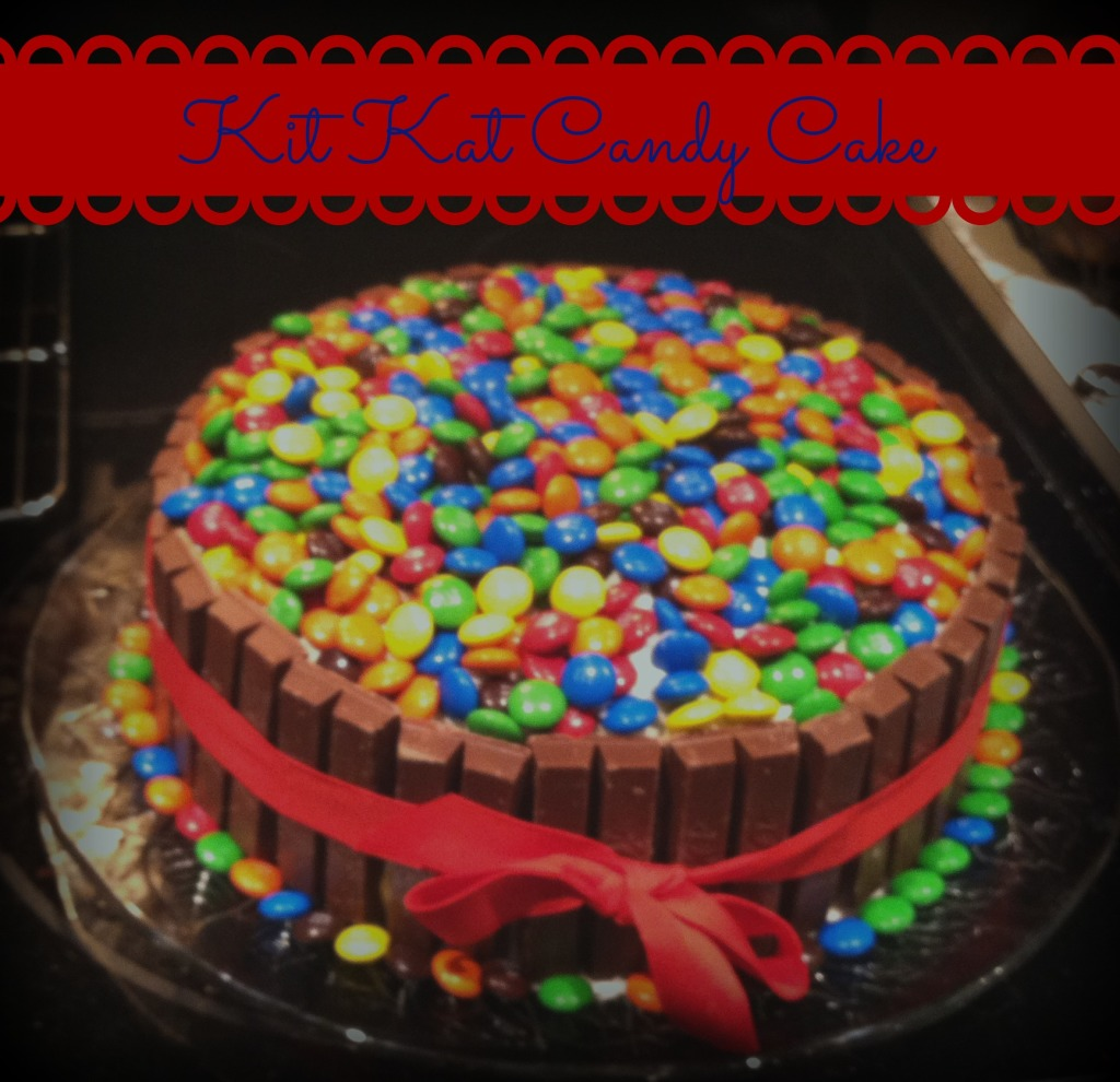 KIt Kat Cake--Super easy to make and everyone will love it!  You can personalize it for any occasion just by changing the color of the M&M's on top!