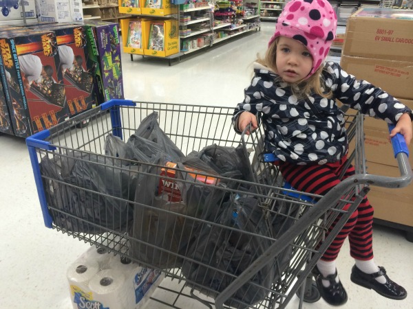 Walmart Checking Out--Don't you just LOVE her outfit? She insisted on dressing herself!#DropShopandOil #ad