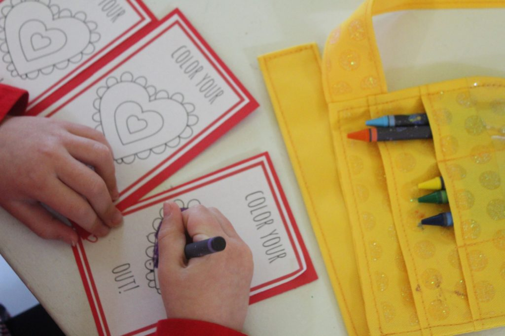 Coloring the printable Valentine's Day cards for kids