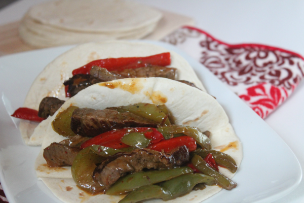 This yummy and easy Sheet Pan Steak Fajitas dinner is such to be a crowd pleaser!