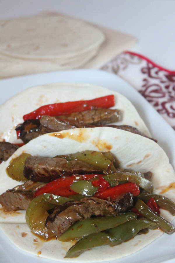 Sheet Pan Steak Fajitas recipe--full of flavor and easy to make!