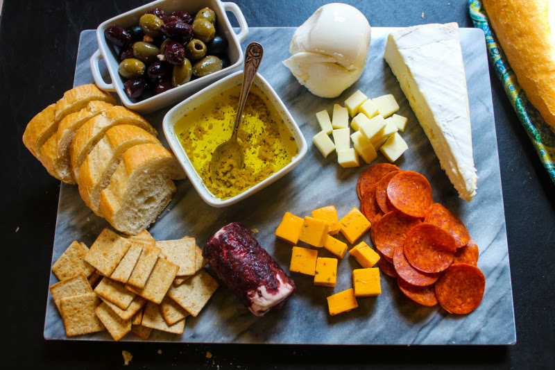 A meat and cheese platter with Garlic Infused Olive Oil is an easy appetizer dish perfect for all of your get togethers!